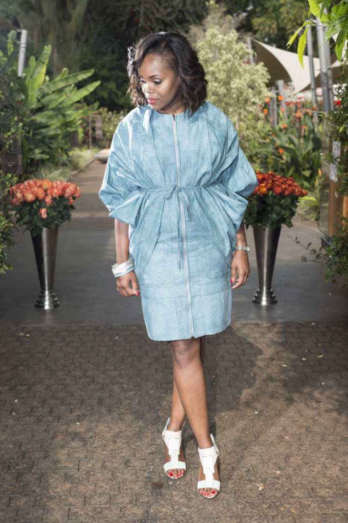 Gorgeous pale turquoise ensemble features pieces (patterned cotton light blue jacket worn over the reversible vest dress) from the SS15 wEIRD collection by Uganda's designer of the same label Gloria Wavamunno.